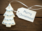 A Blue Merry Christmas on white Label with Christmas Tree Cookie as Christmas Greetings