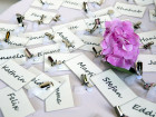 bunch of nametags scattered on a table