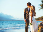 Romantic Wedding Couple Kissing on the Beach at Sunset