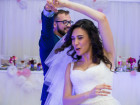Happy newlywed couple having fun during their first dance at wedding reception